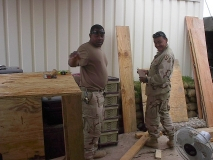 Ssg. Warner and Sgt. Plante building furniture